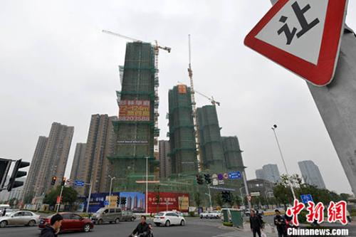 资料图:一处在建商品房。 <a target='_blank' href='http://www.chinanews.com/'>中新社</a>记者 吕明 摄